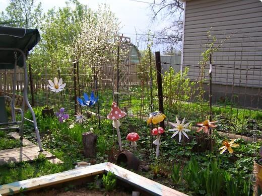 Поделка Вырезание: Садовые цветы из пластиковых бутылок Бутылки. Фото 7
