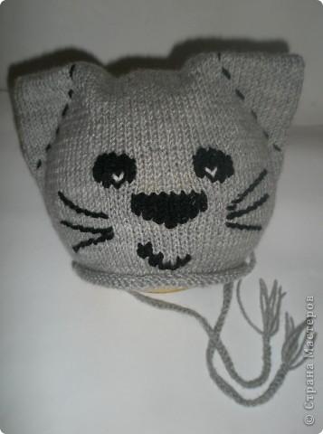 вязаные шапки с мордочками панды.