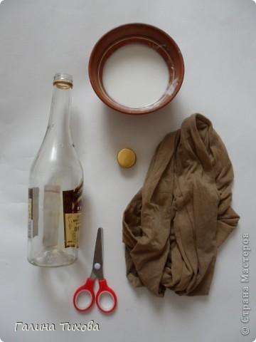 Вот такая бутылка получается, если её декорировать старыми эластичными калготками. Идейный вдохновитель ЭВА <a data-cke-saved-href=