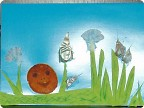 колобок из апельсиновых корок среди часночных зарослей