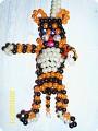 Источник.  Тигр.Я его плела из бус.  Размер высота игрушки 14 см.А можно из бисера.