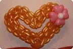 1. 1. Мастер класс по созданию сердца из воздушных шаров.  На изготовение уходит приблизительно 50 шаров для...