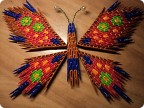 """Модульное оригами  """"Бабочка """".  Красивая бабочка из модулей с пестрым узором крылышек.  Треугольных модулей для сборки..."""