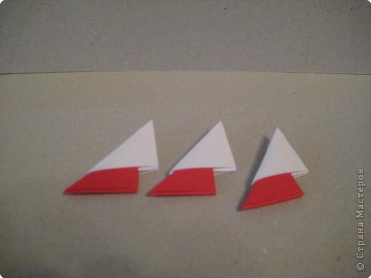 Кукла изготовлена методом модульного оригами. Волосы - из нитей. фото 3