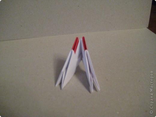 Кукла изготовлена методом модульного оригами. Волосы - из нитей. фото 4
