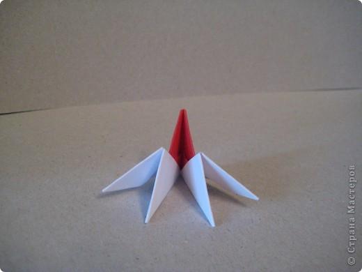 Кукла изготовлена методом модульного оригами. Волосы - из нитей. фото 15