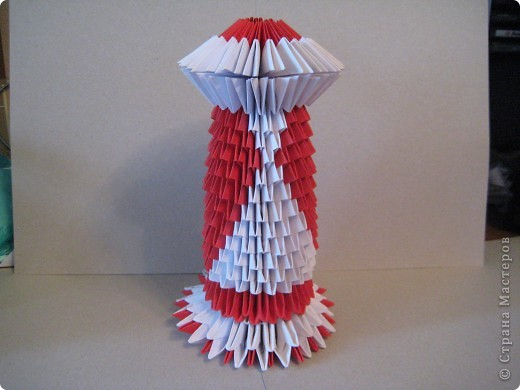 Кукла изготовлена методом модульного оригами. Волосы - из нитей. фото 17