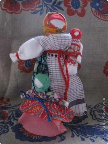 Еще одна из кукол - символ материнского начала.  фото 1