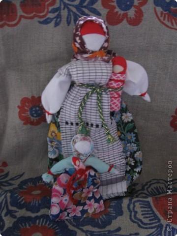 Еще одна из кукол - символ материнского начала.  фото 2