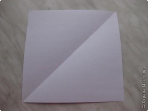Нужно взять лис бумаги квадратной формы.В дужках я буду писать сказку (жил бедный селянин, был у него большой участок земли) фото 1