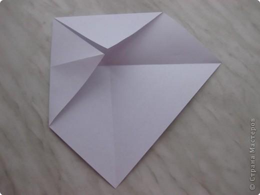 Нужно взять лис бумаги квадратной формы.В дужках я буду писать сказку (жил бедный селянин, был у него большой участок земли) фото 3