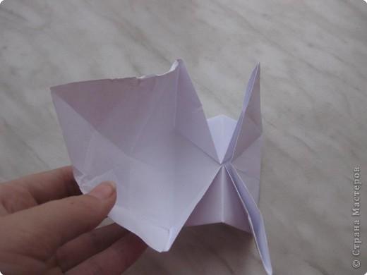 Нужно взять лис бумаги квадратной формы.В дужках я буду писать сказку (жил бедный селянин, был у него большой участок земли) фото 29