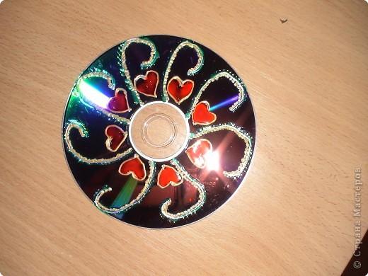 компьютерный диск разрисован витражными красками, свеча так же... фото 2