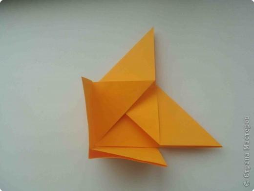 """Такую коробочку или кошелек с секретом я умела делать давно, но забыла. Благодаря энциклопедии """"Оригами"""" (автор Рик Бич), вспомнила.  Вот так выглядят готовые изделия. В чем секрет? Сначала сделаем кошелечек. фото 13"""