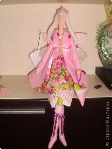 Розовый ангел в пальто фото 1