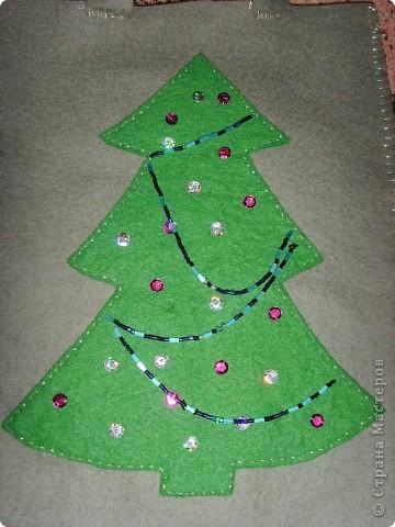 В прошлом году для доченьки сшила мешочек из фетра для подарка. Подарок съели, а мешочек остался. Может кому-нибудь пригодится идейка. Ведь Новый год не за горами. фото 2