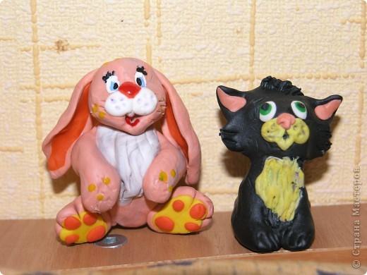 """Признаюсь, что это """" повторялки"""" . Котика увидела в Стране, а зайца нашла в Инете. Воспользовалась идеями и получились символы наступающего 2011 года. фото 1"""