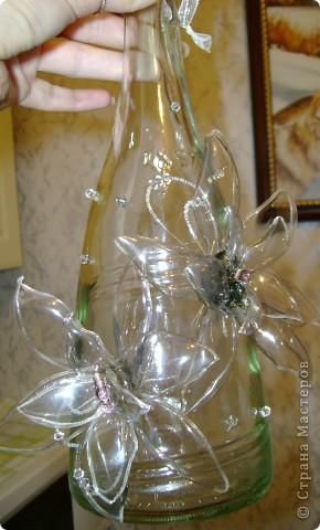 бутылочка с цветочком из пластика фото 3
