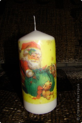 мой первый декупаж на свече.несмотря на то,что очень много складочек,мне понравилось работать со свечкой фото 2
