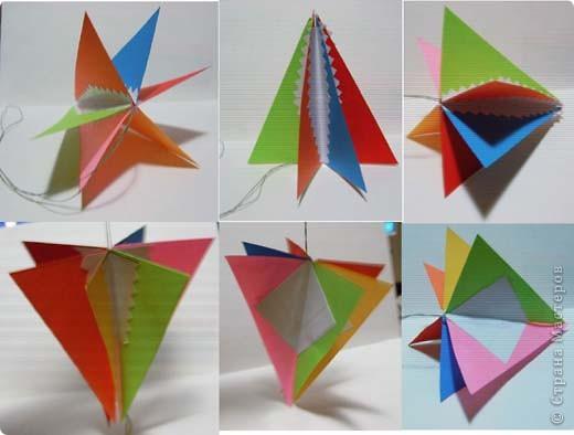 Наипростейшие игрушки на ёлку из бумаги - подвески. Основа - равнобедренный треугольник. Для изготовления одной подвески  используем 2-3 треугольника.Можно и больше...  фото 4