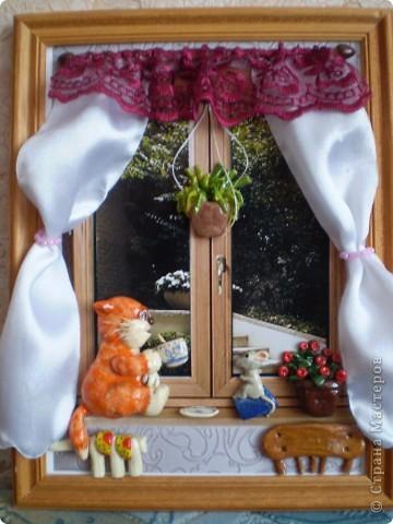 Рыжий котик на подоконнике. фото 1