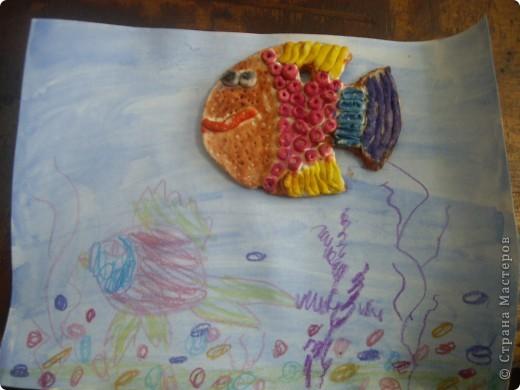 Рыбка в аквариуме.