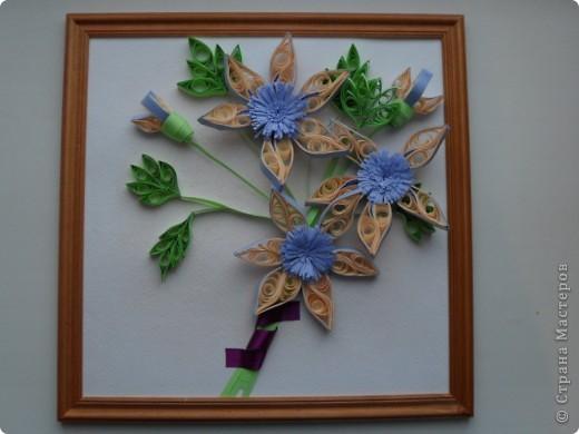 Вот такие у меня получились цветы. Сначала задумала сделать лилии, но накрутились такие цветочки.