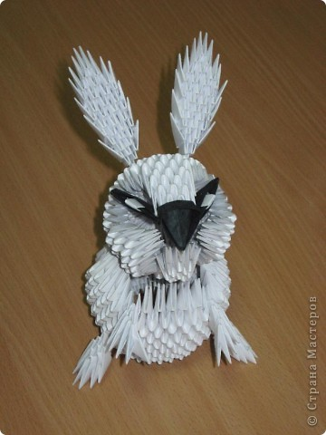 Здравствуйте! Поздравляю всех с наступающим Новым годом!  Увидела в Стране мастеров очаровательного белого кролика, которого сделала Бригантина, и захотелось сделать такого же. Вот что у меня получилось. Тапками не закидывайте, я в модульном оригами новичок. Этот кролик - моя первая работа.  Хочу отдельно поблагодарить Бригантину за предоставленную схему сборки кролика. Кстати, ее можно посмотреть вот по этой ссылке: http://stranamasterov.ru/node/115365?c=favorite фото 1