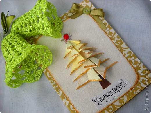 Приятный сюрприз от Nataliya k: http://stranamasterov.ru/user/10381. Наташенька, спасибо тебе за внимание и доброту. Сколько тепла в твоих подарочках, мне очень приятно. Колокольчики теперь на самом видном месте, так приятно держать в руках ажурную красоту. Открытка поразила своей элегантностью и красотой. Золотой снегопад и черный кот - на удачу.