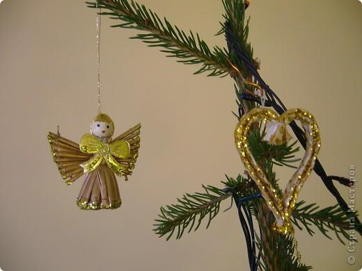 В этом году свою лесную красавицу нарядила исключительно новогодними игрушками из соломки. фото 6