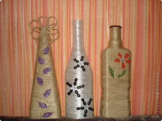 Бутылочки обделанны бечёвкой,немного бисера и бусинок. фото 1