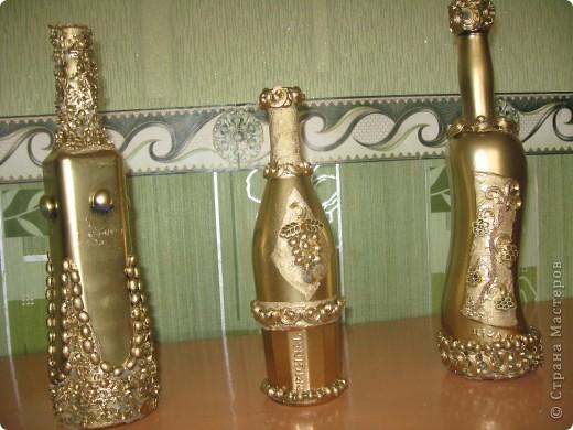 Бутылочки, декорированные макаронами.
