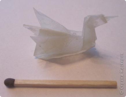 Лебедёночка сложила из кальки. Захотела, чтобы он был жёсткий и устойчиво стоял. Покрыла его эпоксидной смолой... Теперь он как каменный.  фото 1
