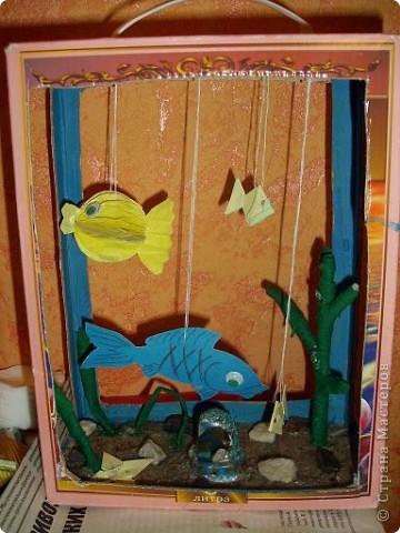Рыбки сделаны из бумаги. Желтая рыбка из объемной бумаги. фото 1