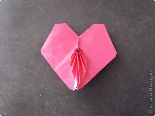 Origami heart with a an accordion folded decoration on top.