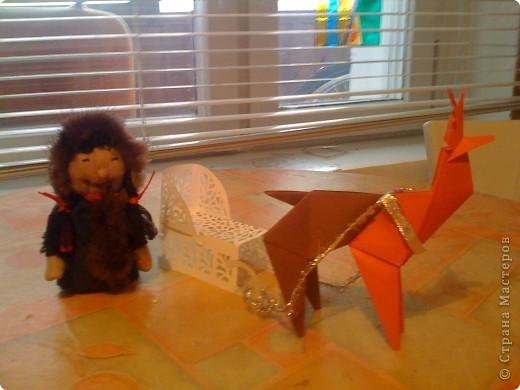 Олень - техника оригами, сани - вырезаны из бумаги, кукла - сшита из капронового носка :) Все мастер-классы найдены на этом сайте. фото 1