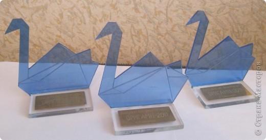 Такие оригамные статуэтки были вручены победителям городской олимпиады по оригами, которая проходила 20 марта в канун юбилея нашего Центра детского творчества. Задание заочного тура предусматривало изготовление открытки к юбилею ЦДТ. фото 24
