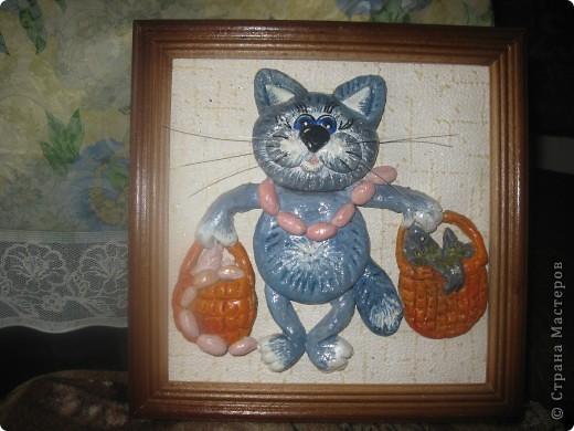 кот с сосисками.