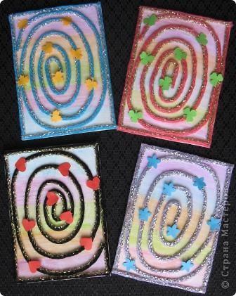 Спиральки из ниточек с люрексом. В ход пошли подарочки-дырокольности. фото 1