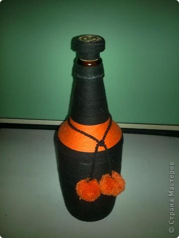 Бутылочка оплетенная нитками. фото 1