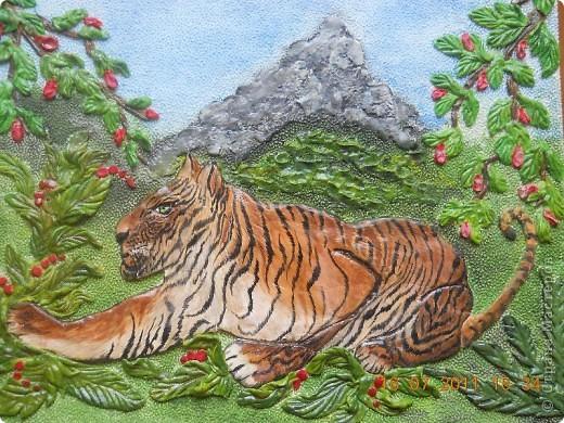 Тигр оформлен в картину........