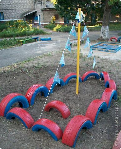 Вот и мы построили лодочку в детском саду из автомобильных покрышек.  фото 4