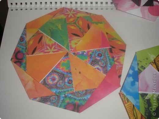 Доброго времени всем жителям ОГРОМНОЙ Страны Мастеров! С данной поделки началось мое увлечение оригами. Это подставочка под горячее или чай. вообщем для гостей. 8 модулей, собираеться без клея.  Взят из книжечки по оригами. найду - выставлю схемку. фото 3