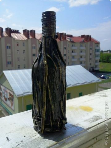 Бутылка кожей фото 7