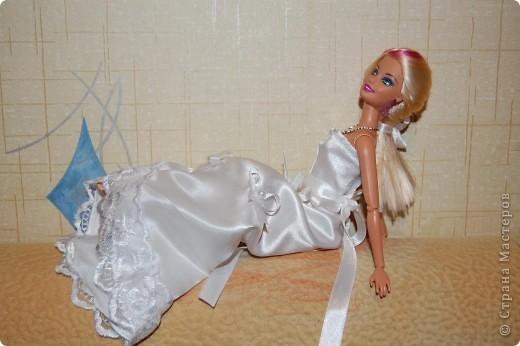 Это мои первые шаги в шитье,шить не умею вот решила попробовать на куклах,как получилось судить вам фото 1