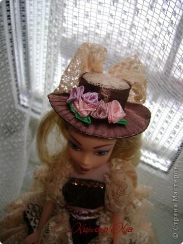 Вот эта куколка мне нравится своим шоколадным платьем и кремовыми кружевами фото 5