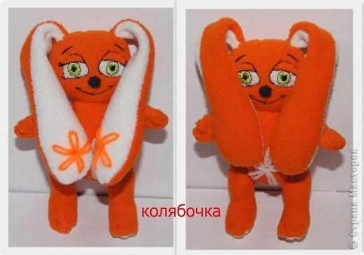 Зайка - моя первая авторская игрушка,сшита по разработанной мною выкройке.Рост- 13,5 см,вместе с ушками - 25см.Материал - флис оранжевый и белый,набивка - синтепон. фото 2