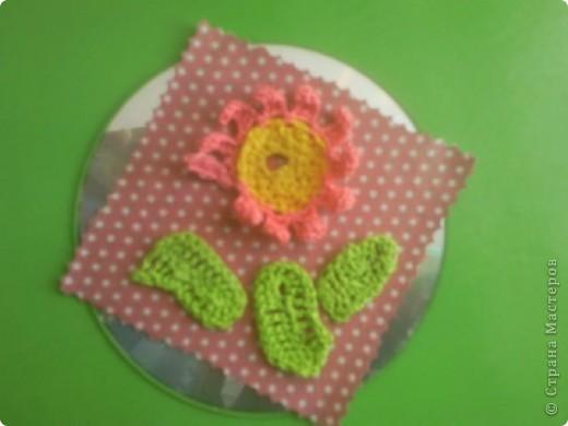 Цветок связанный крючком на диске. фото 1