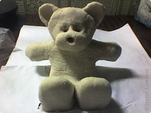 Белый плюшевый медвежонок