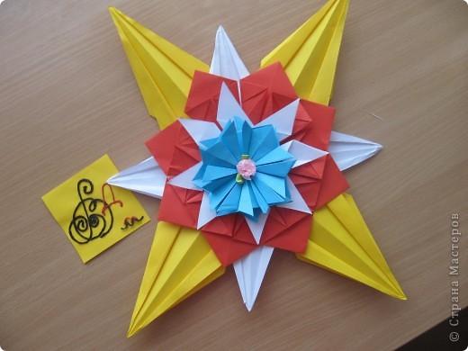 """Мне эта звездочка напоминает снежинку. Я ее сделала из моделей """"крылья, """"ракета"""", """"шатл"""". фото 3"""